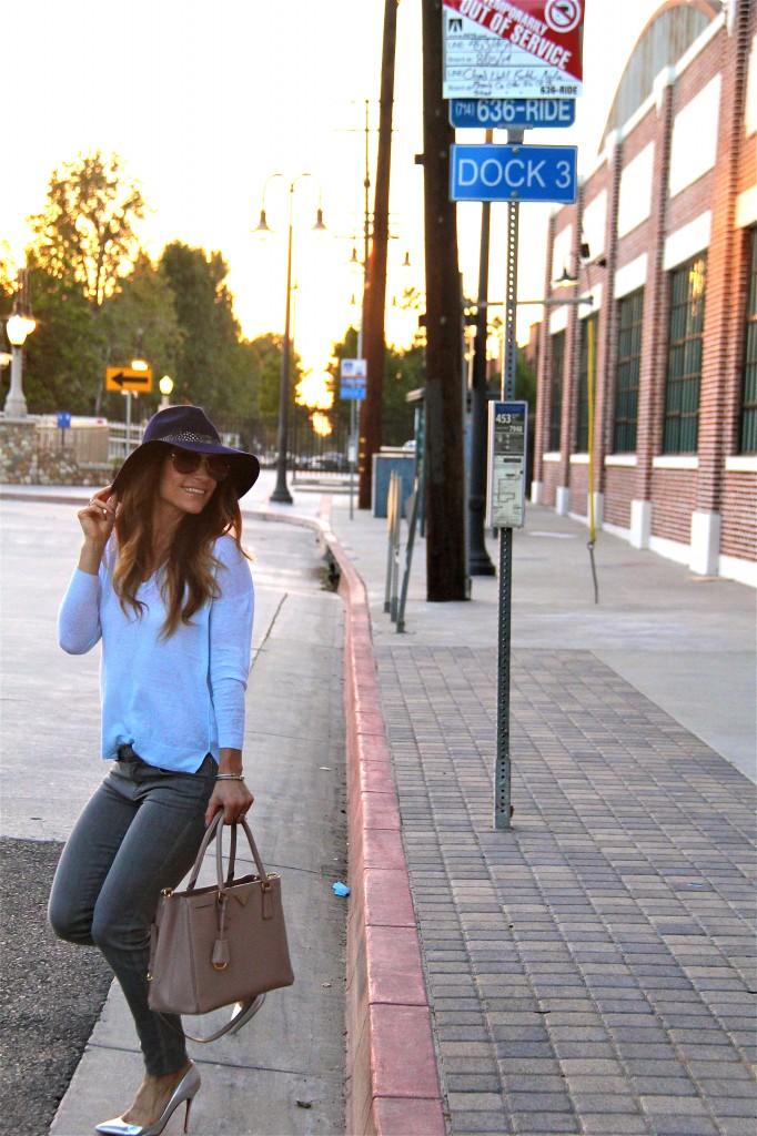 grey jeans, blue sweater, navy fedora