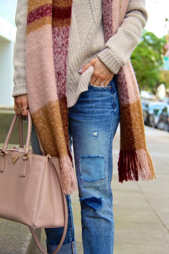 distressed denim, chunky knit sweater