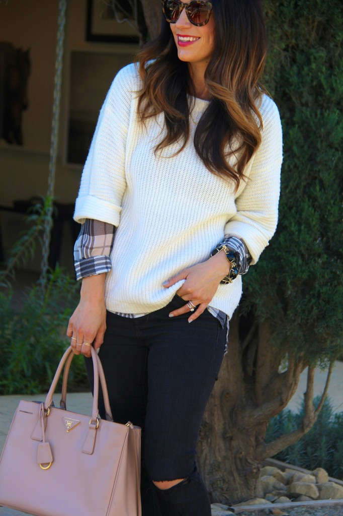 white sweater layered with plaid top