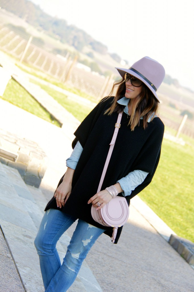 pink fedora, black poncho