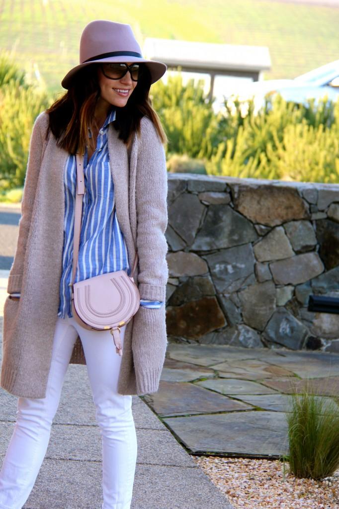 pink fedora, stripe top, white jeans