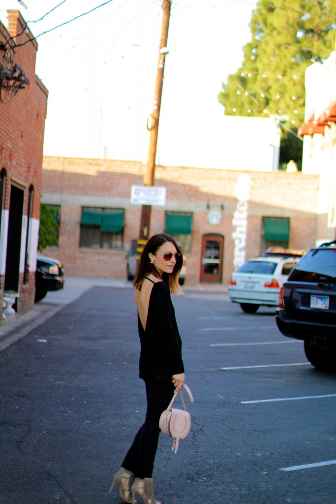 black backless top, all black outfit