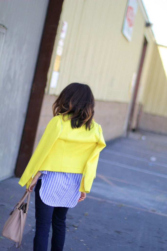 yellow jacket, blue and white striped top